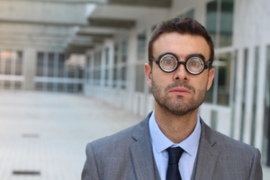 Businessman wearing thick glasses
