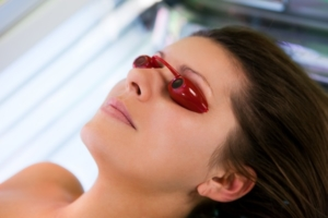 Woman on sunbed wearing goggles