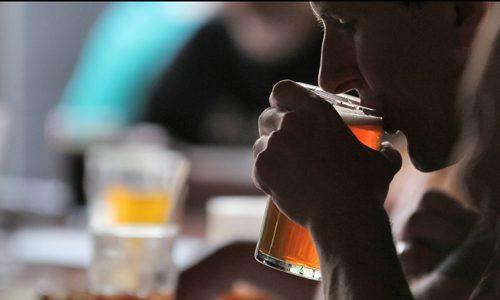 man drinking at a bar