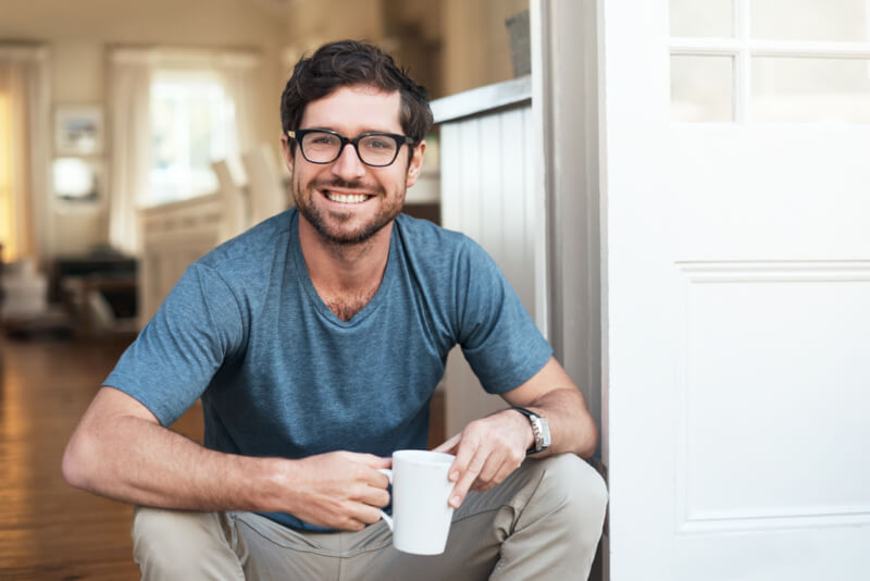 Man sitting with glasses on