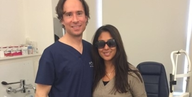 laser eye surgeon allon barsam with his patient