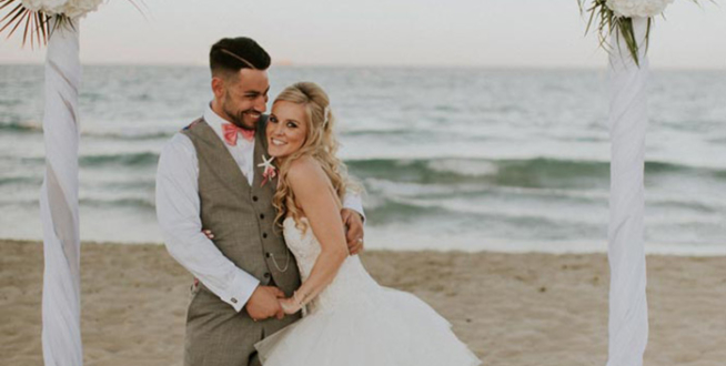 man and woman getting married on the beach