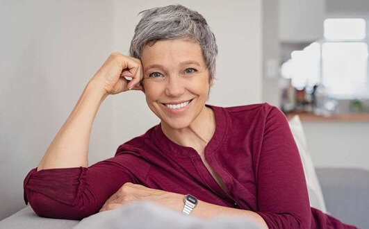 woman smiling on the sofa