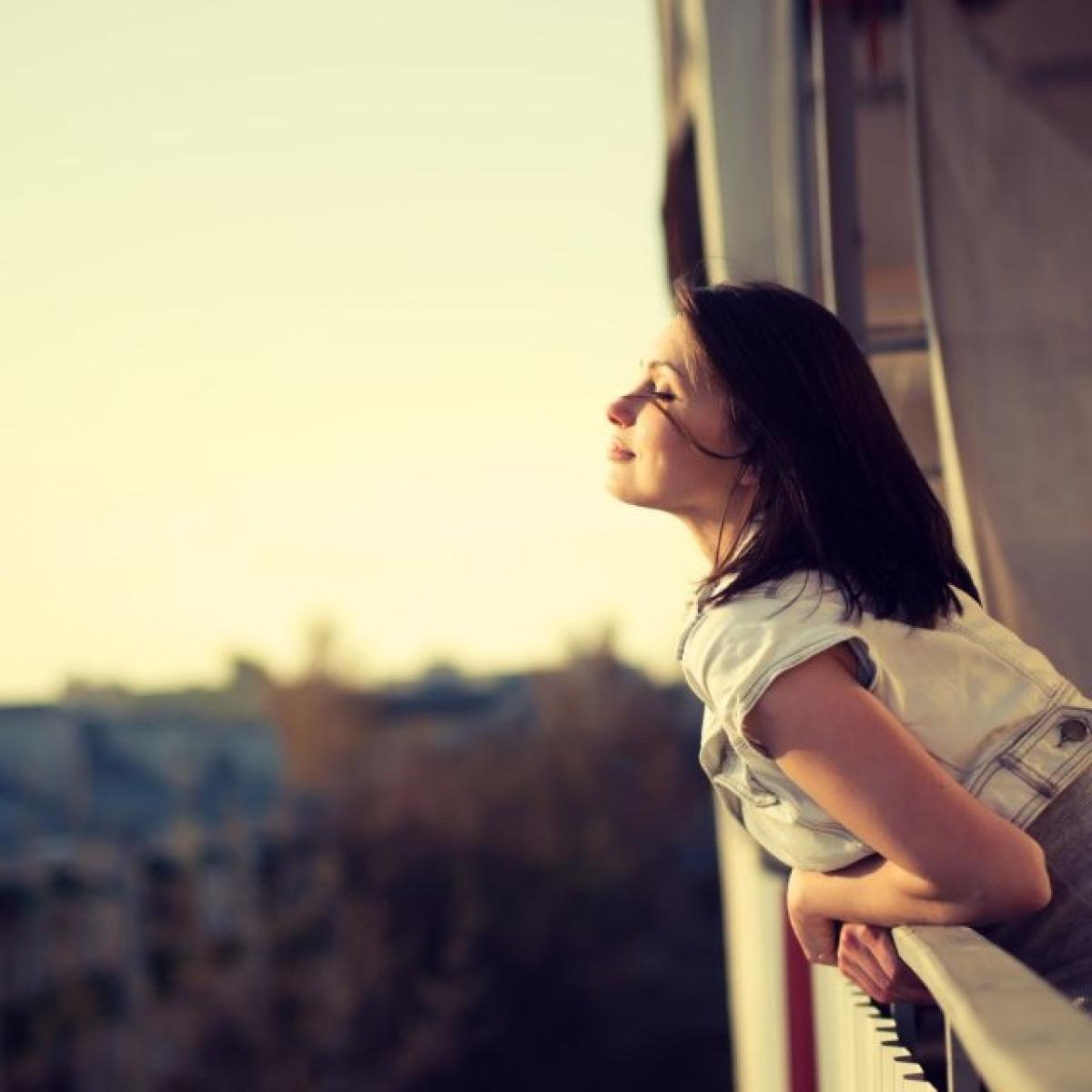 shutterstock sunshine, woman on balcony
