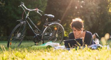 woman-reading-in-field