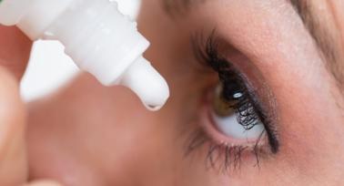 Women dropping eye's liquid on her eye
