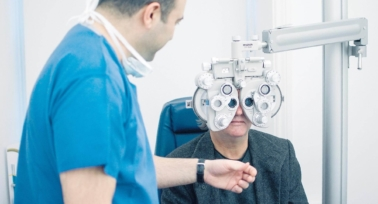 man having eyes checked for laser eye surgery