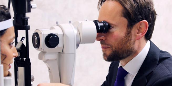 Dr Allon checking eyes