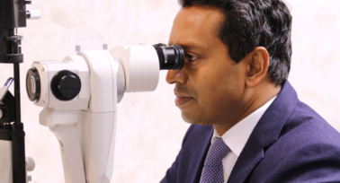 Dr Romesh checking eyes