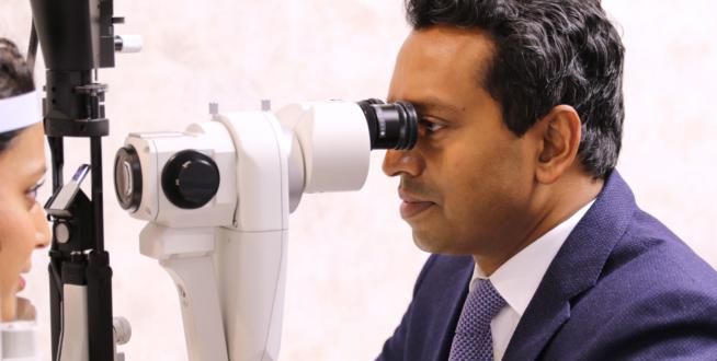 Dr Romesh checking eyes