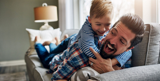 dad-playing-with-son-on-sofa