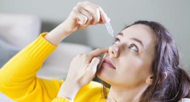 lady applying eye drops